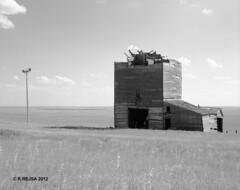 Okaton, SD (rrejsa) Tags: field southdakota rangefinder 150 ghosttown 6x7 telephonepole ilford grainelevator okaton panfrodinal koniomegarapidm
