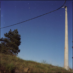 pine tree / pole / moonlight / startrails (OverdeaR [donkey's talking monkey's nodding]) Tags: moon mountain tree 120 6x6 film grass pine night mediumformat square stars 50mm long exposure kodak ps scan pole full negative bronica wires scanned moonlight medium format portra 800 sqa startrails flatbed divcibare f35 c41 5035 zenza zenzanon divčibare maljen zenzanonps cs8800f