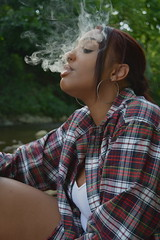 'Smoker' i. (miranda.valenti12) Tags: trees light portrait sunlight green water forest river felicia outside outdoors woods stream wind outdoor smoke windy smoking redhead smokey greenery smoker plaid fee