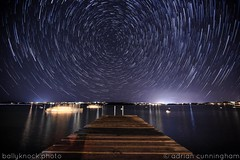 sitting on the dock of the bay (adicunningham) Tags: startrails bermuda harringtonsound island islandlife longexposure night nightscape ocean oceanlife stars