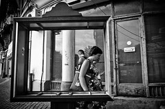 We Were Framed (stimpsonjake) Tags: nikoncoolpixa 185mm streetphotography bucharest romania city candid blackandwhite bw monochrome frame sign woman man centrulvechi