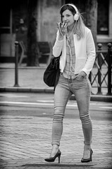 Djeuner (tim-wolverson) Tags: woman female phone headphones mobile jeans legs lille france blackandwhite streetphotography
