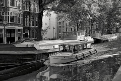 Paradis is a small boat (Mr.White@66) Tags: boat boot raamgracht amsterdam bw blackandwhite bancoenero fujifilm fujifilmx70 canal gracht trees shadows light houseboat ark monochrome