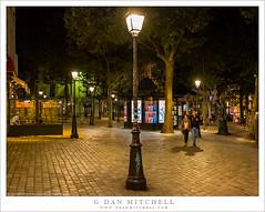 A Couple, Street Lights, Park (G Dan Mitchell) Tags: montmartre paris france europe night photography couple man woman walk past street lights cobble stone travel