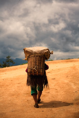 tug to venture into new territory~ Yunnan (~mimo~) Tags: china honghe mimokhairphotography yunnan woman worker basket straw load uphill sky clouds tugtoventureintonewterritory