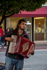 Earning a Living (jsnmckenzie) Tags: victoria vancouverisland britishcolumbia canada inner harbour outdoor outside bc accordian man busker people street streetphotography