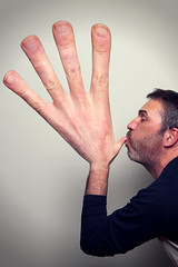 Hand inflation (Paul O' Connell) Tags: ireland portrait people dublin man male canon fun photography funny humor large blowing humour mischief bizarre bigger inflation helpinghand bighand onemanonly pauloconnell lendahand handinflation