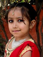 Cute girl (dhakalmira) Tags: nepal wedding red party portrait girl beautiful beauty smile face fashion canon costume kid dress sweet innocent ceremony makeup marriage ornaments mysterious kathmandu shawl hindu eyeliner kajol lehenga