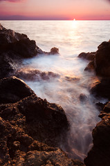 Sunset at Hali'i Kai (tyler hayward) Tags: ocean longexposure sunset vacation water beautiful canon hawaii nd murakami bigisland polarizer cokin cablerelease lavarocks mirrorlockup 1635mm kokia 5dmkii sittingonsharppointyrocks onesunsetontherocksofmany