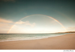 Rainbow (john white photos) Tags: sea beach coast rainbow wave australia clean coastal tasmaniabayoffires