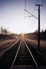 (xbacksteinx) Tags: morning winter light slr lines analog sunrise 35mm early hp track mood moody 28mm tram slidefilm rails expired nikonf3 fujiprovia100 nikkor28mmf28ai