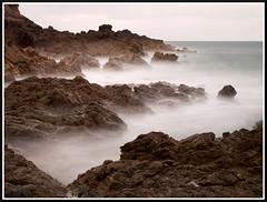 Baie d'Ecalgrain (1) (Lucien Vatynan) Tags: sea mer beach stone rocks waves olympus normandie vagues normandy plage manche rochers cotentin ecalgrain epl1 mygearandme
