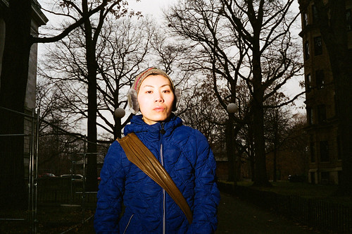 blue trees winter woman cold girl weather lady 35mm dark asian person photography japanese flash rangefinder scene spooky jacket ear melancholy canonet giii negatives muffs 2011