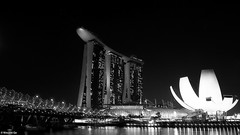 Marina Bay Sands Hotel (The91) Tags: longexposure bridge light bw film night marina hotel bay singapore 28mm 14 negative plus nikkor sands 50 ilford fm3a panf nikonfm3a ddx ilfordpanfplus50 seriese nikkoraf105mmf2ddc marinabaysandshotel