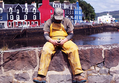 @wrk (Burnt Out Chevrolet) Tags: uk people house man color colour colors yellow mobile work person scotland fisherman colorful colours phone painted sony working cell clothes using western overalls colourful alpha scallop a200 mull isle isles balamory tobermory hebrides texting oilskin