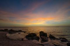 Causeway Sunsets (Noah Bolanowski) Tags: ocean sunset sea sky orange usa cloud sun beach beautiful clouds sunrise island evening amazing sand nikon rocks colorful pretty florida pebbles boulders stunning colourful sanibel sanibelisland cloudporn manfrotto captiva captivaisland d7000 nikond7000