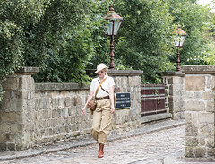 1940'S LADY WALKING, CRICH_DSC_0684_LR_2.0 (Roger Perriss) Tags: 1940s criche d750 stonework bridge lady woman girl trousers bag