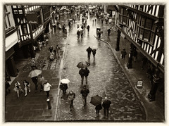 Wet Streets (dunne_s) Tags: second rain wet street sepia umbrella shops cobbles explore