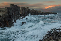 The restless sea (Howard Ferrier) Tags: oceania rock bombo clouds ocean sunset pacificocean kiama afternoon newsouthwales waves coast australia sea bomboquarry au time materials