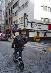 神保町 自転車に乗るひと Chiyoda-ku, Tokyo (ymtrx79g ( Activity stop)) Tags: street color slr film bicycle japan analog tokyo kodak 35mmfilm 東京 135 yashica chiyodaku jinbocho 自転車 街 jimbocho 神保町 写真 千代田区 銀塩 フィルム yashicafx2 kodakultramax400 yashicaml28mmf28 歩行走行 walkandrun 201203blog