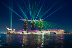 Dance of Light - (Singapore) (blame_the_monkey) Tags: city travel water skyline architecture night reflections mba singapore asia lasers bluehour portfolio sands lasershow lightshow blending marinabay