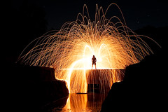 Taking one for the team... (Stuart Addelsee) Tags: longexposure light lightpainting man reflection wool water night canon dark fire eos fly flying long exposure dam steel spin trails australia brisbane burn burnt spinning figure flare sparks spark spillway steelwool quensland 400d