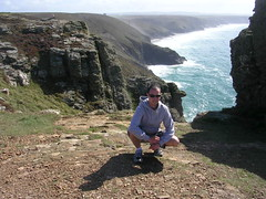 Me crouching on St. Agnes Head (southglosguytwo) Tags: sea me water coast hoodie jon rocks cornwall cliffs atlanticocean crouch 2010 whatsnottolike stagneshead