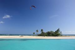 escape (gcarmilla) Tags: ocean blue sea sky palms island mare puertorico blu cielo azzurro palme parachute oceano isola desertisland paracadute isoladeserta parachutesurfing palomiinito