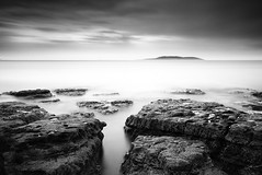 Whisper of a Storm (Ger208k) Tags: ireland sea blackandwhite dublin seascape clouds island rocks le malahide greyscale lambayisland bigstopper gerardmcgrath