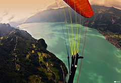Lake Brienz (Daniel Wildi Photography) Tags: wood sky mountains alps water beautiful clouds forest switzerland village view brienz brienzersee hills paragliding glider advance paraglider 2012 berneseoberland lakebrienz cantonofbern danielwildiphotography