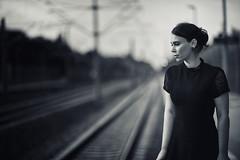 Backtracking (fehlfarben_bine) Tags: woman portrait monochrome dof mood emotions tracks trainstation nikondf 850mmf14 berlin lostinthought railway alone profile elegant deep heart