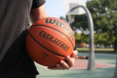 Holding a Wilson basketball on outdoor court 2 (yourbestdigs) Tags: adult player outdoor leisure guy copy white practice sitting day brown bench ball field arm male orange one jersey closeup team court basket holding person basketball space man side hand sport