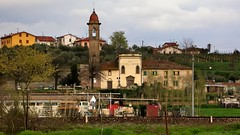 Railside rural village with church - River Arno valley, between Pisa and Florence, Italy (edk7) Tags: nikoncoolpix4500 e4500 edk7 2004 italy italia tuscany toscana church railroad railway rr rwy town village rural country countryside landsape vista campanile belltower bell dome house architecture building oldstructure junk vineyard