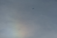 Sun dog (Sculptor Lil) Tags: canon700d dslrsingleexposure london aircraft atmosphericoptics clouds jet sky sundog weather