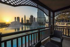 A View of the Dubai Fountain and Burj Khalifa during sundown (arielcaguin) Tags: burjkhalifa dubai dubaifountain dubaihotel dubaioperahouse dubaipark burjdubai thepalacedowntowndubai thedubaifountain terrace balcony sundown skyscraper