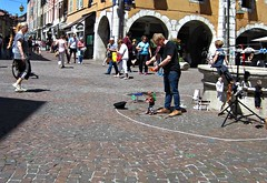 Annecy (AmyEAnderson) Tags: annecy france europe spring puppeteer marionette puppets entertainment street sidewalk bricks sunny people crowd