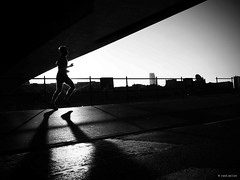 Morning Jogging (Ren Mollet) Tags: basel blackandwhite bw backlight renmollet rhein riverside jogging man morgen morning mann mollet schatten schwarzweiss penf zuiko 35mm