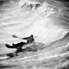 The Sea Kayak (AndyCrutt) Tags: uk sea england blackandwhite bw man art byn blancoynegro water monochrome sport square mono surf kayak wave olympus surfing spray canoe wetsuit saltburn soulopeople1
