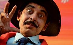 / The Magician - A Portrait (pallab seth) Tags: portrait india face nikon expression candid indian magic stall expressive powerful bengal magician shantiniketan westbengal 2011 workingpeople santiniketan bolpur poushmela tamronaf70300mmf456dildmacro blinkagain d3100 tamronaf70300mmf456dildmacrolens          grambanglarchobi
