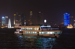 Cruising the Huangpu River (Erik Lykins) Tags: china city travel cruise vacation urban tourism water skyline night buildings river 50mm lights boat asia downtown waterfront shanghai chinese cities tourist destination pudong bund excursion attraction 50mmf14 rivercruise huangpuriver d7000