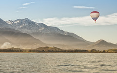 Hot Air Balloon over Kaikoura (Vemsteroo) Tags: winter newzealand sky snow seascape motion mountains nature landscape freedom countryside nikon solitude ballon 85mm tranquility snowcapped adventure celebration national vista southisland hotairballoon f18 exploration abundance kaikoura geographic mountainrange d90 misthaze