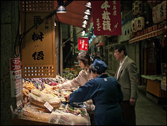 (David Panevin) Tags: street people food japan shop kyoto display arcade olympus staff pickles e3 nishikimarket tsukemono  nishikiichiba sigma1850mmf28exdcmacro nakagyoku davidpanevin tominokojidori shijoagaru
