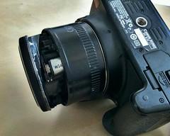 Bad Day for Clarks + Tech (LexnGer) Tags: canon lens 50mm bobo blogged brokenlens ouchie droppedmycamera cameradoctor cellphoto lensguts brokeanotherone