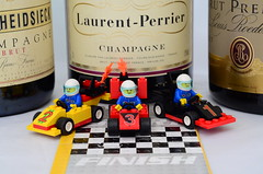 ah!  the taste of victory ! (The Urban Adventure) Tags: red cars 50mm one nikon lego bokeh champagne mini f1 racing silverstone finish winner formula figures d7000 brickr