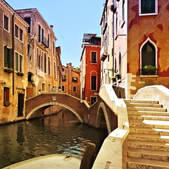 Historic Venetian dark reds and muted yellows (Bn) Tags: world life voyage street city trip travel venice houses windows light red sea summer people italy music orange sun color reflection heritage water beauty weather yellow river boats island mirror islands site italian ancient topf50 colorful warm europe italia ride taxi shoreline shift pedestrian tourist taxis canals unesco explore shade rowing gondola venetian richness topf100 venezia hue renaissance topf200 palaces gondolier itali veneti vaporetti 100faves 50faves 200faves