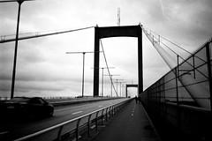 Pushing the bridge (gborgskij) Tags: lvsborgsbron d76 11 115min kentmere 100 olympus xa bridge gothenburg skateboarding hisingen rangefinder