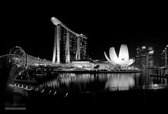 Sands in Mono (syphrix photography) Tags: singapore cityscape city marina bay light black white monochrome landscape syphrix 2016 outdoor night x100s fujifilm asia south east panorama stitch central business district financial tourism sands helix bridge art science museum