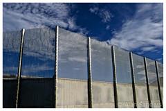 DSCF3105_v1 copy copy (Alan Sanders) Tags: alan sanders fuji xt1 xf23mm portland verne prison dorset weymouth fence barbed razor wire blue sky