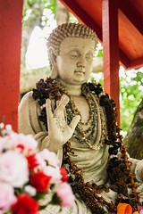 At Peace (pandababy611) Tags: statue byodoin temple hawaii religion culture red bokeh