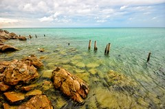 Rocky Shoreline (mswan777) Tags: lake michigan turquoise water pilings rocks shore coast seascape sky clouds storm calm peaceful scenic color summer polarizer nature outdoor great lakes nikon d5100 sigma 1020mm